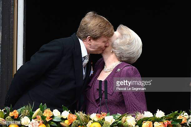 Princess Beatrix of the Netherlands and King Willem Alexander appear on the balcony of the Royal Palace to greet the public after her abdication and...