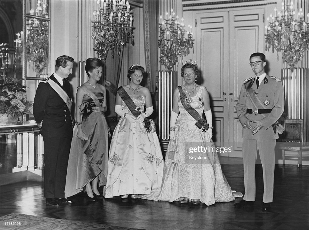 Princess Beatrix of the Netherlands and Queen Juliana of the Netherlands (1909 - 2004) seen on a State Visit to Brussels, 31st May 1960. L - R; Prince Albert of Belgium, later King Albert II of Belgium, Princess Paola of Belgium (later Queen Paola of Belgium), Princess Beatrix of the Netherlands, Queen Juliana of the Netherlands, King Baudouin of Belgium (1930 - 1993).