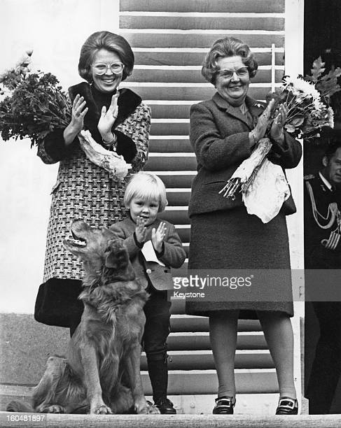 Princess Beatrix of the Netherlands her eldest son WillemAlexander Prince of Orange and Queen Juliana of the Netherlands applaud a performance by the...