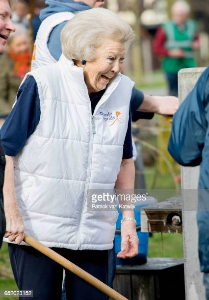 Princess Beatrix of The Netherlands laughs as she volunteers for NL Doet in the the kindergarden on March 11 207 in IJsstelsteijn The Netherlands NL...