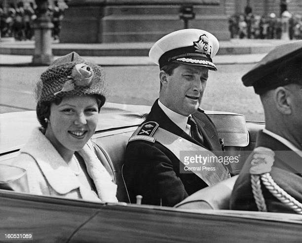 Princess Beatrix of the Netherlands on her way to the Royal Palace of Brussels with Prince Albert of Belgium after her arrival in the city during a...