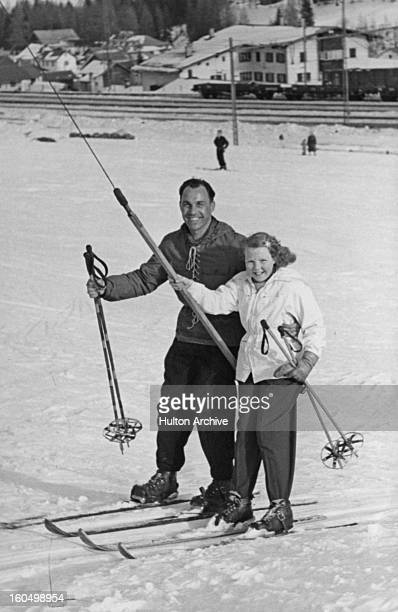Princess Beatrix of the Netherlands on the ski lift with her instructor during a holiday in St Anton, Austria, 12th February 1949.