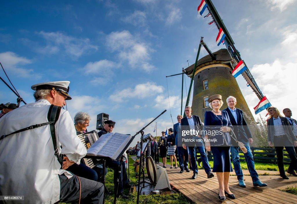 ROELOFARENDSVEEN, NETHERLANDS - OCTOBER 14: Princess Beatrix of The Netherlands opens the renovated windmill Googermolen on October 14, 2017 in Roelofarendsveen, Netherlands.