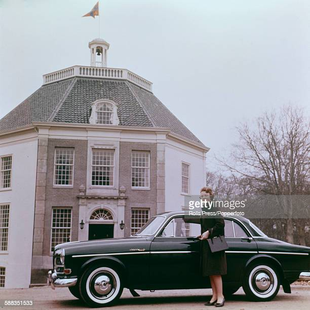 Princess Beatrix of the Netherlands pictured standing beside a Volvo car outside her residence Castle Drakensteyn in the Netherlands circa 1968