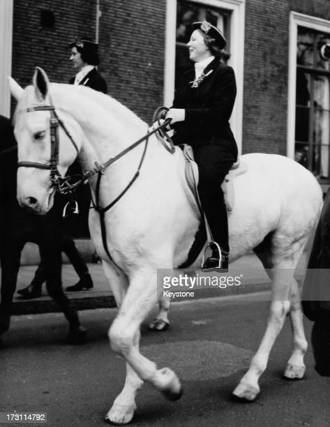 Princess Beatrix of the Netherlands riding a white horse during a parade at a students' reunion at Leiden University Leiden Netherlands 27th January...