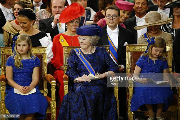 Princess Beatrix of the Netherlands sits with her granddaughters Princess CatharinaAmalia of the Netherlands and Princess Alexia of the Netherlands...