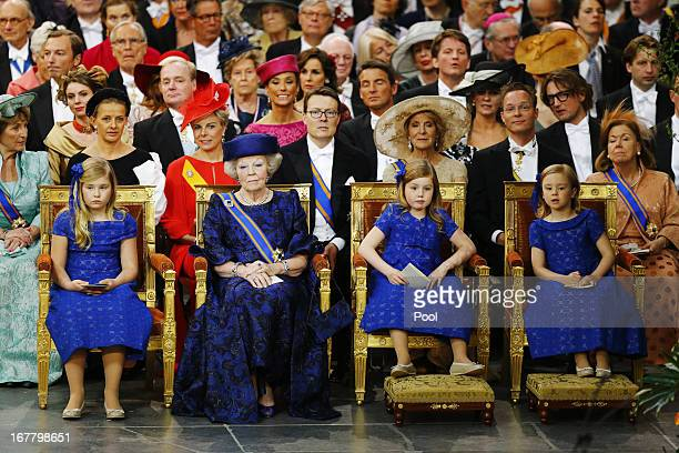 Princess Beatrix of the Netherlands sits with her granddaughters Princess CatharinaAmalia of the Netherlands Princess Alexia of the Netherlands and...