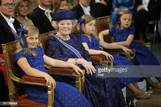 Princess Beatrix of The Netherlands sits with her granddaughters Princess Catharina Amalia Princess Alexia and Princess Ariane during the...
