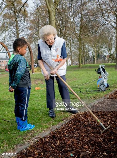 Princess Beatrix of The Netherlands speaks to children as she volunteers for NL Doet in the the kindergarden on March 11 207 in IJsstelsteijn The...