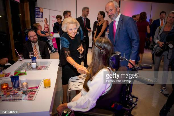 Princess Beatrix of The Netherlands speaks with board members and patients during the dance event Free to Move at the Zuiderstrandtheater on August...