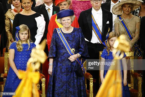 Princess Beatrix of the Netherlands stands together with her granddaughter Princess CatharinaAmalia of the Netherlands during the inaugaration...