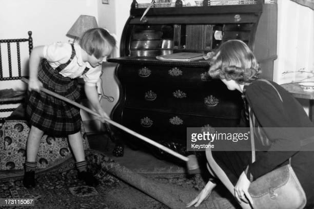 Princess Beatrix of the Netherlands sweeping up at her primary school 'De Werkplaats' in Bilthoven Netherlands 1946