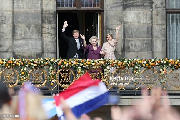 Princess Beatrix of the Netherlands with King Willem Alexander and Queen Maxima appear on the balcony of the Royal Palace to greet the public after...
