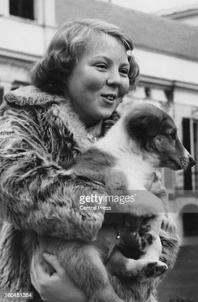 Princess Beatrix with a pet dog at Soestdijk Palace, Netherlands, on her thirteenth birthday, 31st January 1951.
