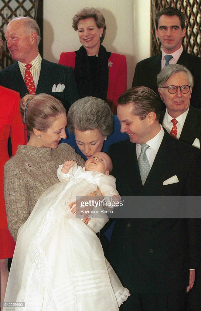 Princess Benedikte (mother of Alexandra) kissing the baby. Behind, A-Marie & Pce Niocolas of Greece