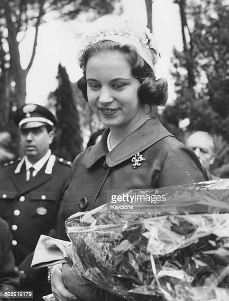 Princess Benedikte of Denmark holding a bouquet of flowers as she visits the Ostia Antica ruins Rome April 21st 1964