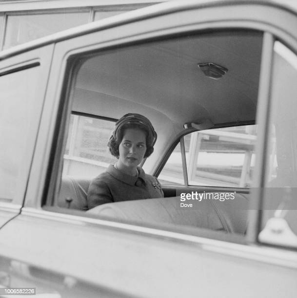 Princess Benedikte of Denmark pictured seated in the rear seat of a car at London Airport on 14th June 1965