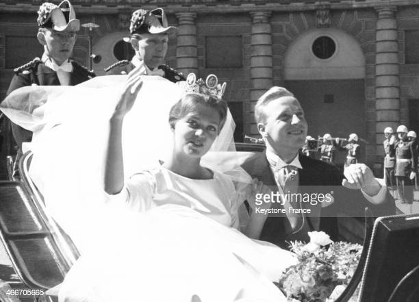 Princess Birgitta and Prince Johann of Hohenzollern in a carriage driving through town after their wedding ceremony on May 25 1961 in Stockholm Sweden