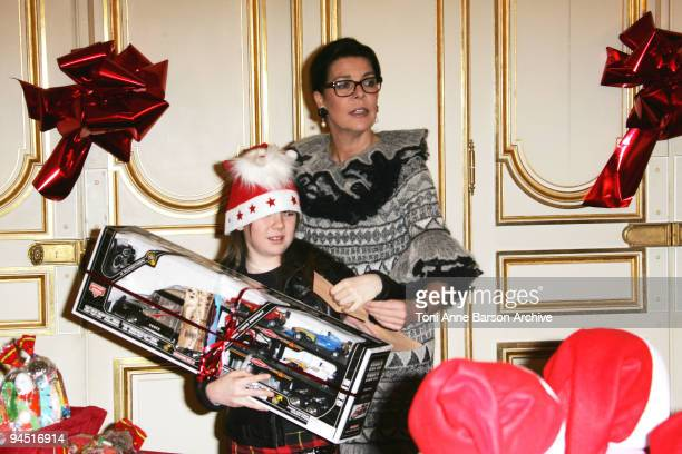 Princess Caroline of Hanover and Princess Alexandra of Hanover distribute presents for the Monaco Christmas Tree at Monaco Palace on December 16 2009...