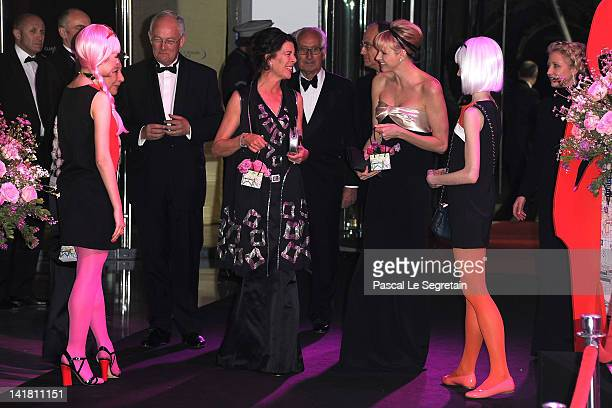 Princess Caroline of Hanover and Princess Charlene of Monaco attend the 'Swinging London' Monaco Rose Ball 2012 at Sporting MonteCarlo on March 24...