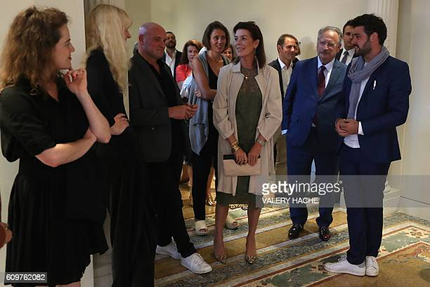 Princess Caroline of Hanover flanked by French choreographer JeanChristophe Maillot and Curator Benjamin Laugier visits the 'Danse Danse Danse'...