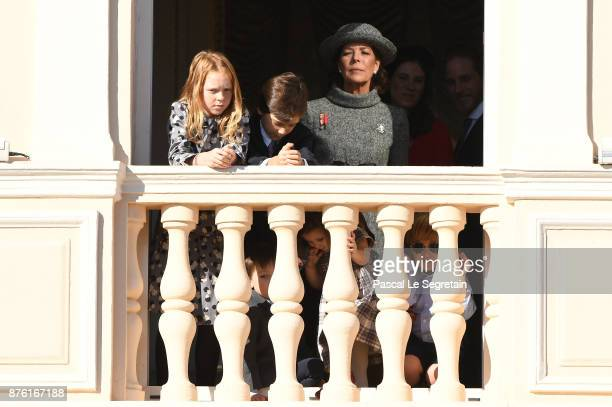 Princess Caroline of Hanover greets the crowd from the palace's balcony during the Monaco National Day Celebrations on November 19 2017 in Monaco...