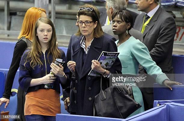 Princess Caroline of Hanover her daughter Alexandra and former figure skater Surya Bonaly leave after attending the World Figure Skating...