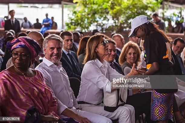 Princess Caroline of Hanover holds a girl's hands as Ambassador of Brazil in DR Congo Paulo Uchoa Ribeiro Filho looks on in Kinshasa on September 26,...