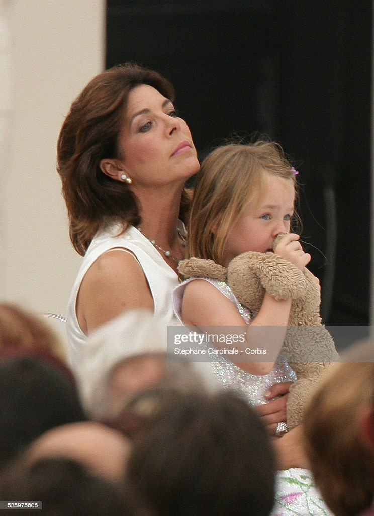 Princess Caroline of Hanover holds her daughter Princess Alexandra during Prince Albert II's key ceremony following his coronation mass held in the morning.