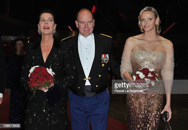 Princess Caroline of Hanover Prince Albert II of Monaco and Charlene Wittstock arrive to attend the Monaco National day Gala concert at Grimaldi...