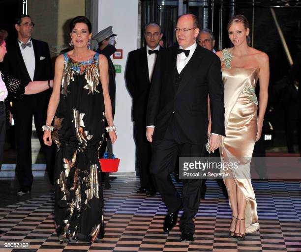Princess Caroline of Hanover, Prince Albert II of Monaco and Charlene Wittstock arrive to attend the Monte Carlo Morocco Rose Ball 2010 held at the...