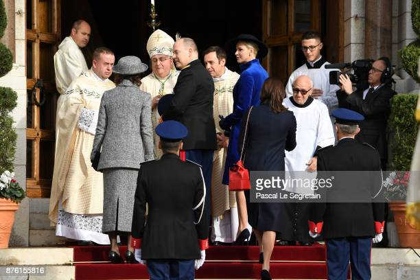 Princess Caroline of Hanover Prince Albert II of Monaco and Princess Charlene of Monaco arrive at the Cathedral of Monaco before a mass during the...