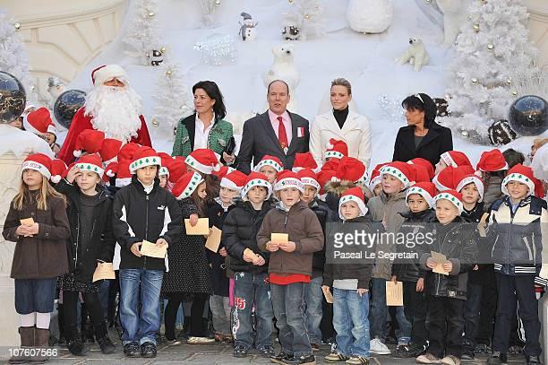 Princess Caroline of Hanover Prince Albert II of Monaco Charlene Wittstock and Princess Stephanie of Monaco attend the 'Arbre de Noel' for Monaco...