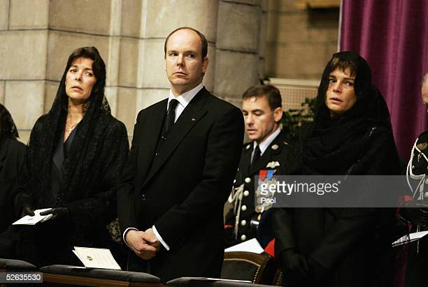 Princess Caroline of Hanover Prince Albert of Monaco and Princess Stephanie of Monaco are seen inside the Cathedral at the funeral service of...