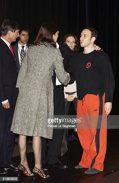 Princess Caroline of Hanover shakes hands with director of Monaco's school dance Yuval Pick as she opens the Monaco Dance Forum on December 15 2004...
