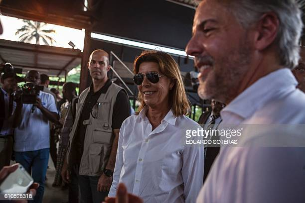 Princess Caroline of Hanover smiles as Paulo Uchoa Ribeiro Filho, Ambassador of Brazil in DR Congo looks on in Kinshasa on September 26, 2016 during...