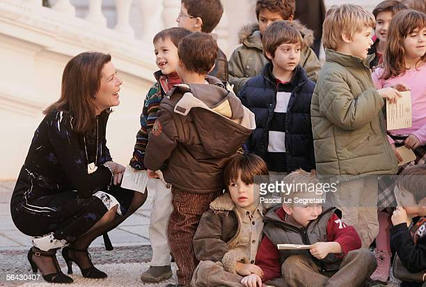 Princess Caroline of Hanover speaks with kids as part of the Christmas Tree ceremony in the courtyard of the Monaco Palace on December 14 2005 in...