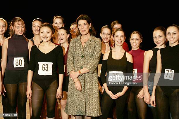 Princess Caroline of Hanover stands with students as she opens the Monaco Dance Forum December 15 2004 in Monte Carlo Monaco