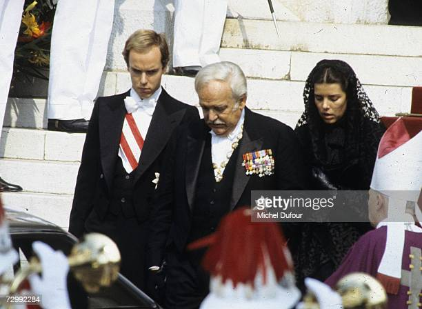 Princess Caroline of Monaco a member of the Grimaldi family walks with her brother Prince Albert of Monaco and her father Prince Rainier of Monaco at...