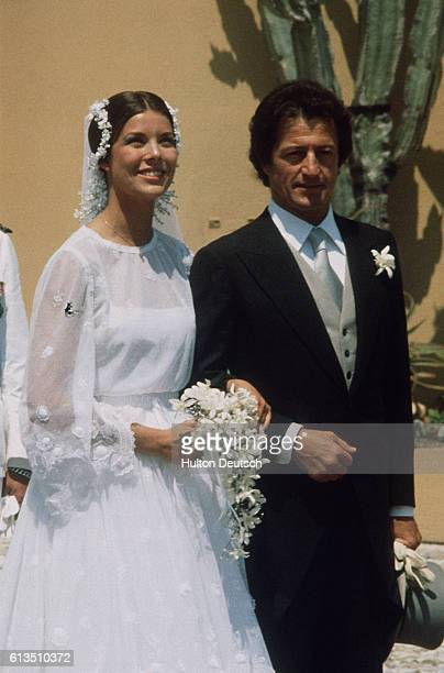Princess Caroline of Monaco jubilant on the arm of Phillipe Junot after their Monaco wedding