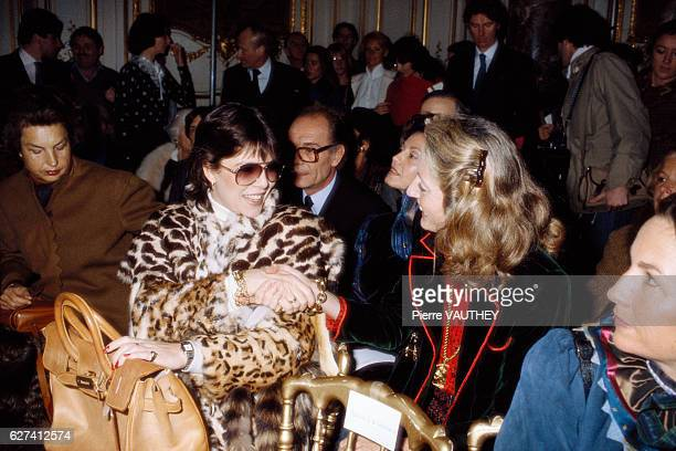 Princess Caroline of Monaco shakes hands with a woman while attending a fashion show in Paris French designer Emanuel Ungaro is showing his 1982...