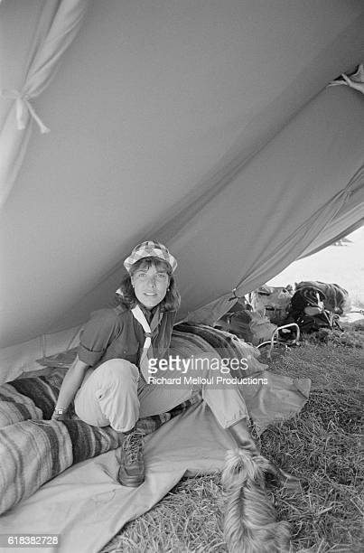Princess Caroline of Monaco sits in a tent while camping in Marchaise France with the Monaco Girl Scouts