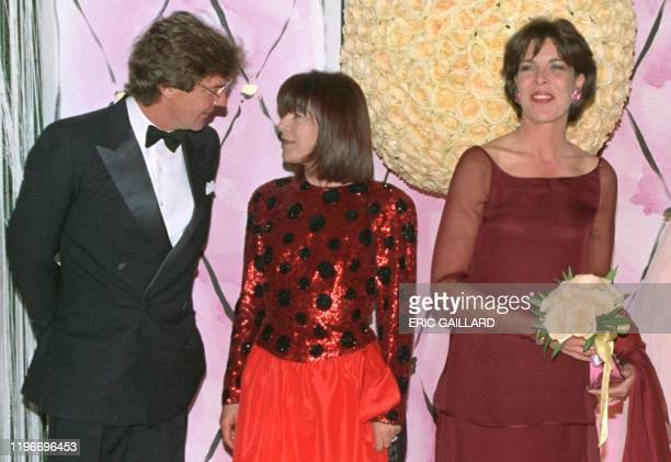 """Princess Caroline of Monaco smiles 28 March as she arrives at the charity """"Bal de la Rose"""" while Prince Ernst August of Hanover chats Elisabeth-Anne..."""