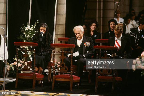 Princess Caroline Prince Rainier and Prince Albert attend the funeral of former American actress Princess Grace Kelly who died in a car crash on...