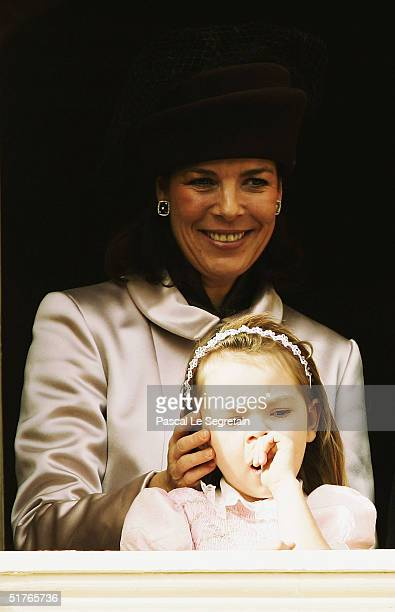 Princess Caroline with her daughter Princess Alexandra stand at the balcony as part of the National Day Celebrations on November 19 2004 in Monte...