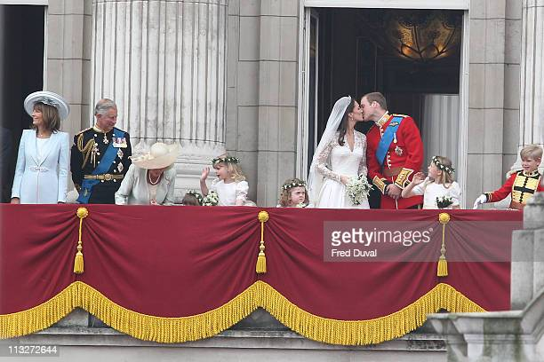 Princess Catherine,Duchess of Cambridge and Prince William, Duke of Cambridge kiss each other on the balcony of Buckingham Palace following the Royal...