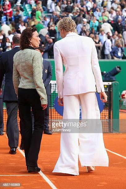 Princess Charlene and ElisabethAnne de Massy leave the court after the trophy presentation following the final between Roger Federer of Switzerland...