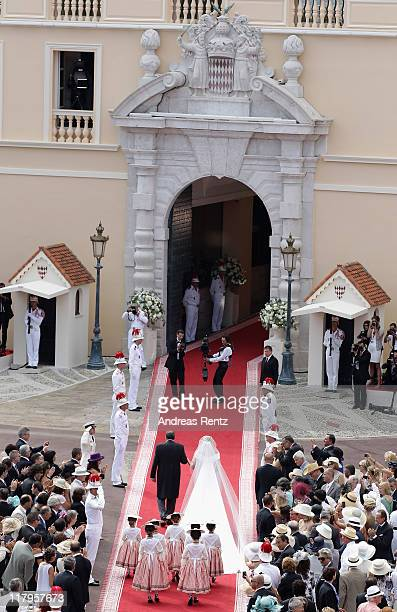 Princess Charlene de Monaco and her father walk down the red carpet prior to the the religious ceremony of the Royal Wedding to Prince Albert II of...