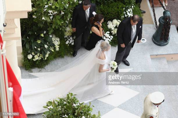 Princess Charlene de Monaco walks prior to the the religious ceremony of the Royal Wedding to Prince Albert II of Monaco in the main courtyard at...