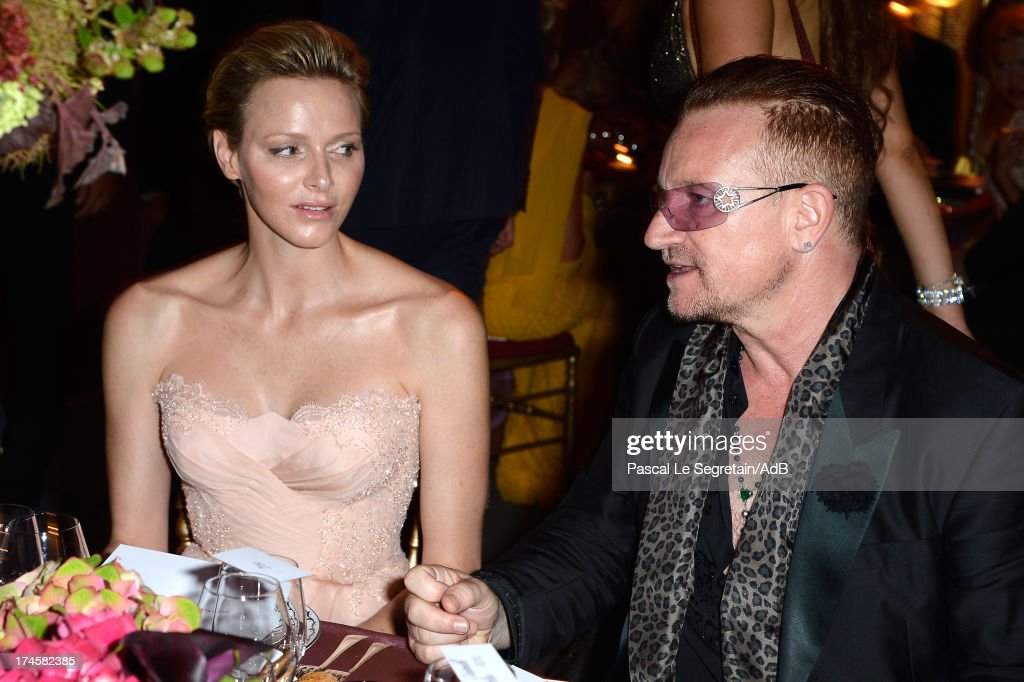 Princess Charlene of Monaco and Bono attend the dinner at the 'Love Ball' hosted by Natalia Vodianova in support of The Naked Heart Foundation at Opera Garnier on July 27, 2013 in Monaco, Monaco.